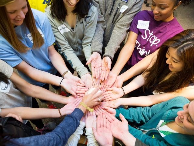 Image of Students Reaching Out