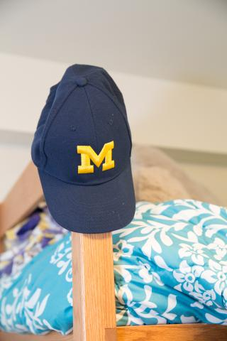 Image of a UM hat on a bedpost