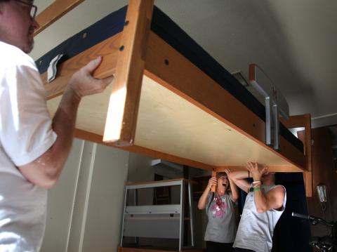 Image of Michigan Parents lifting a loft