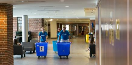 Students moving bins in East Quad