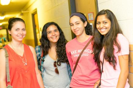 Image of 4 Students in Hallway