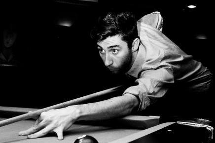 Pool player in black and white