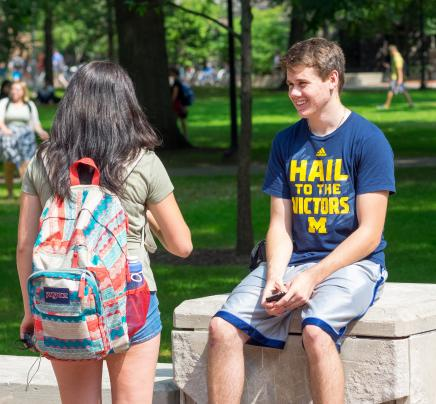 Image of students talking on the Diag