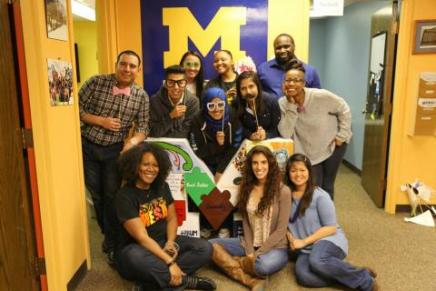 MESA members posing with a decorated M