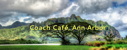 "A landscape of mountains and trees with the words ""Coach Cafe, Ann Arbor"""