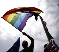 Image of people holding a rainbow flag
