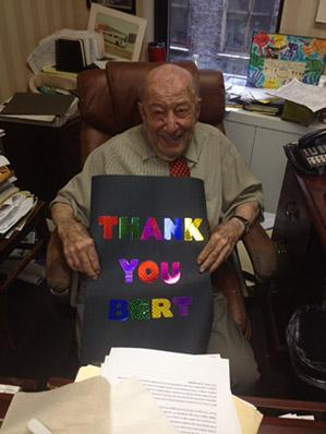 """Bert Askwith holds """"Thank you"""" card signed by U-M students."""