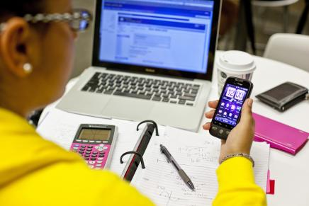Image of student checking phone