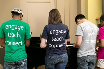 "Students wearing ""engage, teach, connect"" shirts"