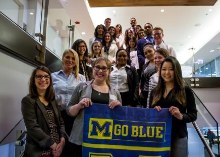 Students Holding a GO BLUE banner