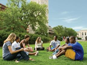 U-M students sit on the grass