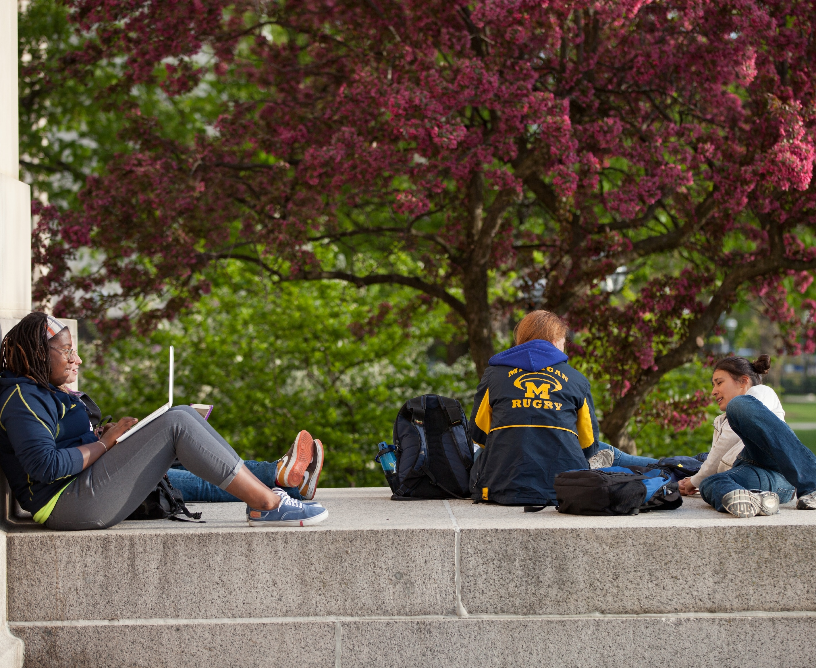 Members of a U-M student organization talk together outside.