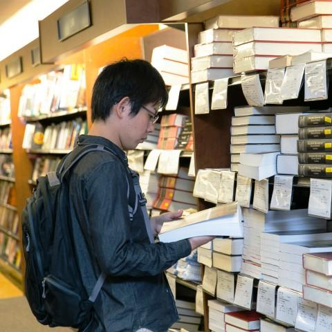 student in a bookstore