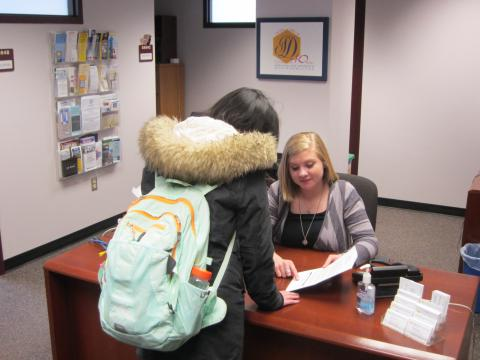Photo of student getting help from Services for Students with Disabilities