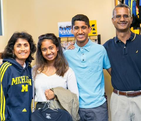 Parents posing with students