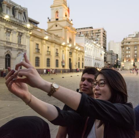 Students taking selfies while traveling