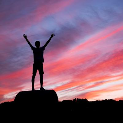 A young person on top a mountain