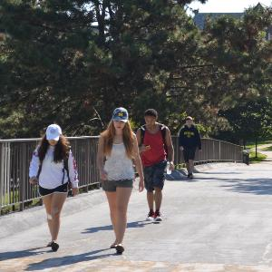 students walking across bridge