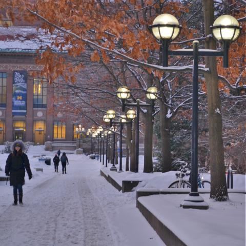 students walking on the diag in the snow