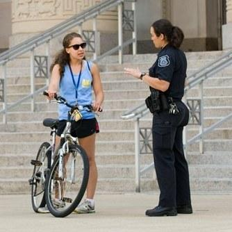 U-M Division of Public Safety and Security Officer and biker