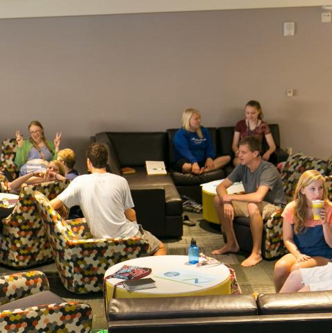 U-M students chatting in residence hall lounge