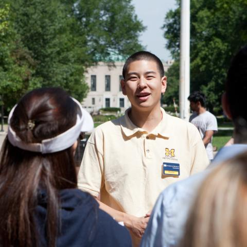 student worker guiding a tour