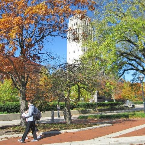 Students walking by Burton Tower in fall