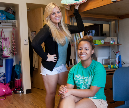 Students posing in a dorm