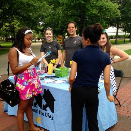 Students at Beyond the Diag table