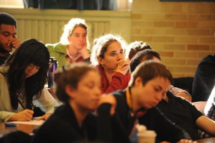 Student seated in classroom amongst other students