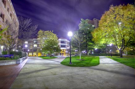 Campus pathways lit up at night
