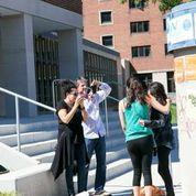 Students taking photo in front of dorm