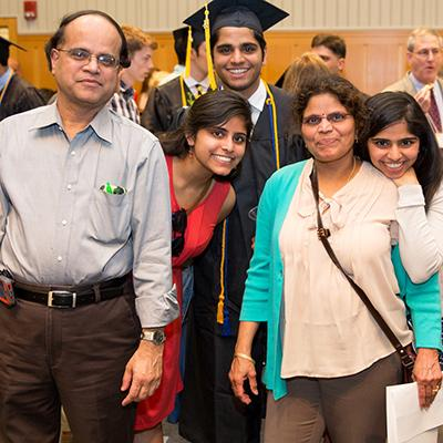 A family celebrates with a new graduate.