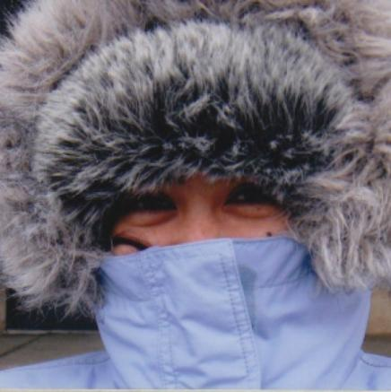 Woman bundled up against the cold