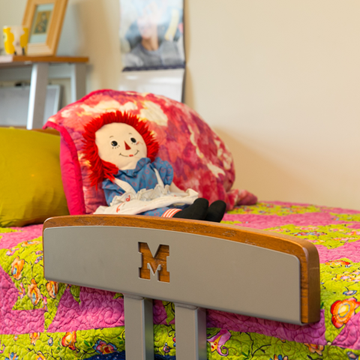 Rag doll on a bunk bed