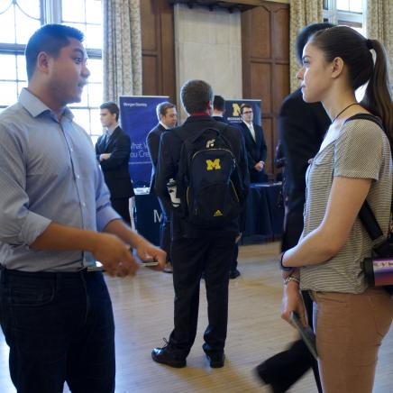 Recruiter and Student Talking at a Career Fair