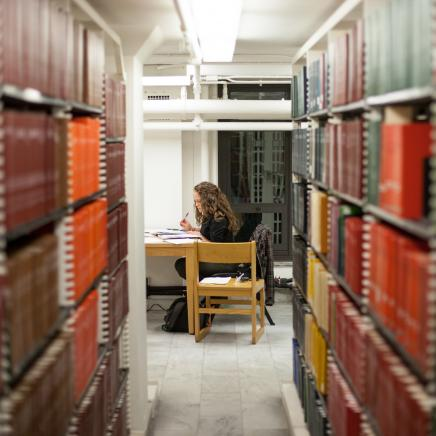 A student studies in the Hatcher Graduate Library.