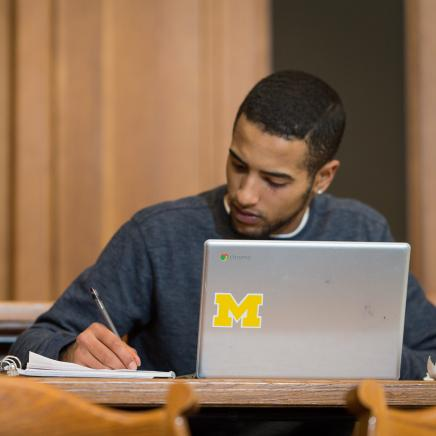 A student studies with his laptop