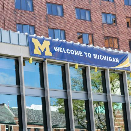 Welcome to Michigan banner across the South Quad building